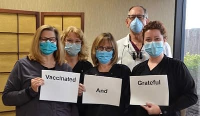 vaccinated staff group photo