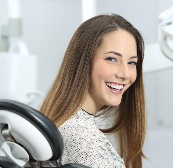 girl smiling dental chair