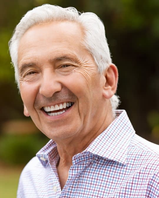 man smiling with dental implants