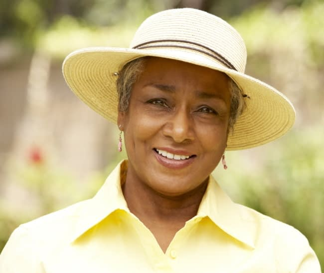older woman with hat smiling